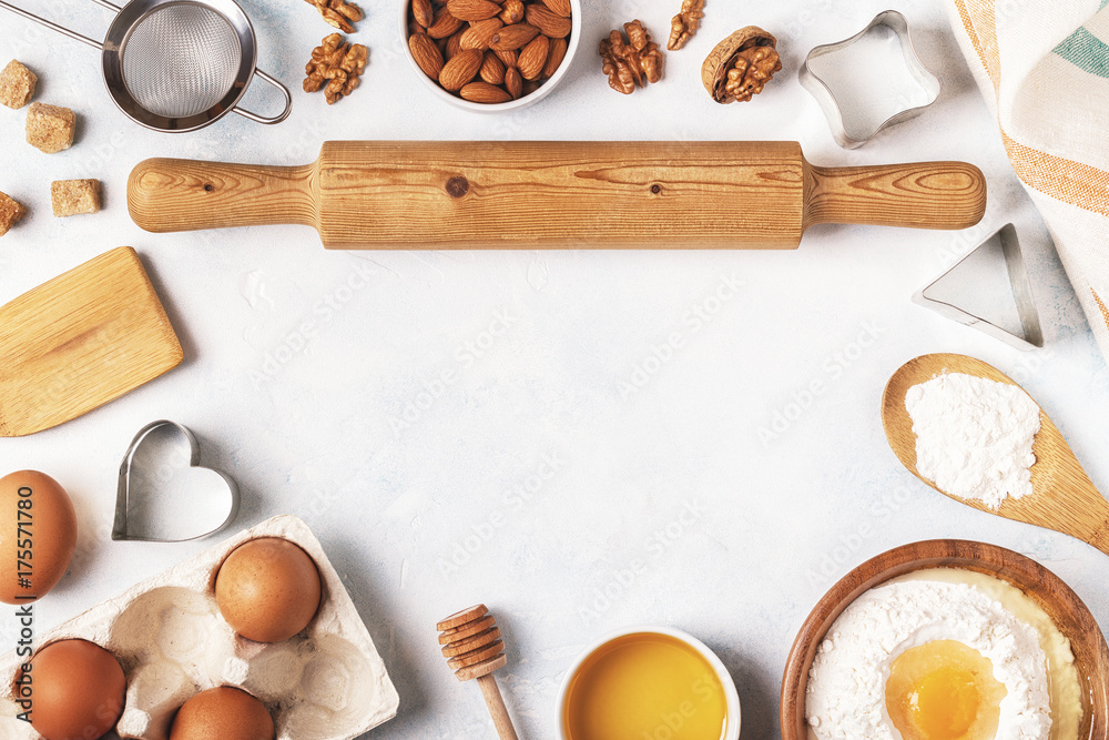 Fototapety, obrazy: Ingredients for baking  - flour, wooden spoon, eggs.