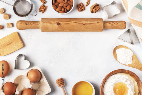 Photo  Ingredients for baking  - flour, wooden spoon, eggs.