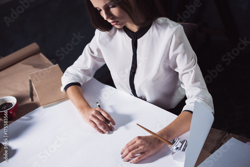Fototapety, obrazy: Architect working on drawing table in office