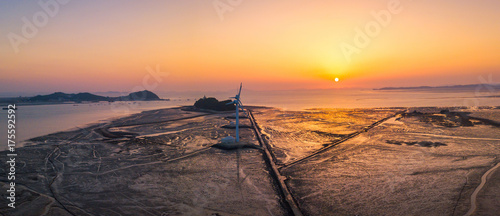 Платно Aerial view Sunset of wind turbine in Daebudo Island,South Korea.