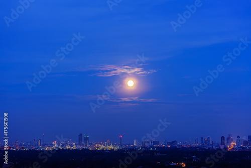 Scenery of full moon rising in blue hour , Bangkok , Thailand - Buy