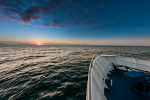 Boat Bow And Sunset Over Ocean