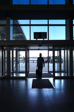 Man Walking With The Suitcase At The Airport