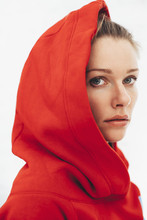 Portrait Of A Woman Wearing Red Hoodie