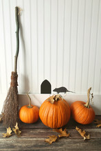 Pumpkins And Broom Leaning Aga...