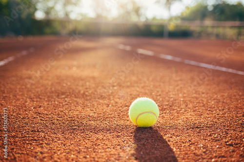 Photo  Tennis ball on clay court