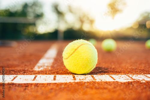 Fotografering  Tennis ball on tennis court