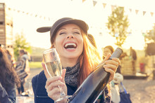 Happy Young Woman Drinking Win...