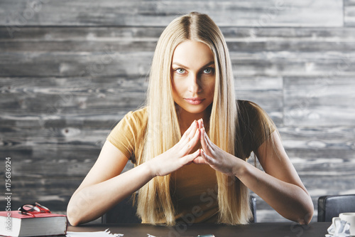 Confident blonde woman at workplace