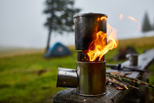 Cooking In A Pot Over The Firewood Stove
