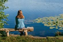 Teen Girl Reading Book Outside...
