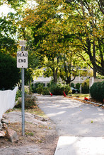 "A Sign Reading ""dead End"" On A Nice Street."