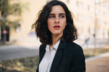 Portrait Of A Beautiful Woman In Suit On The Street