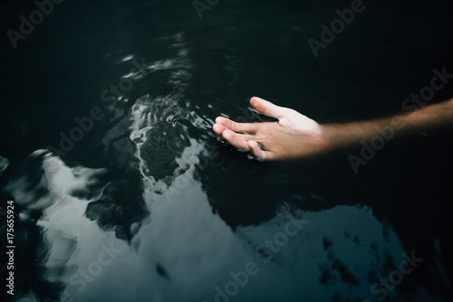 Hand in body of water
