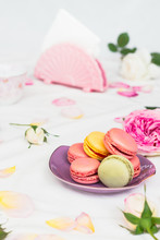 Macarons And Roses On An Embro...