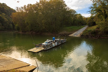A Ferry Moves Passengers Across The Green River In Kentucky