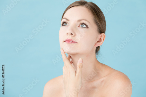 portrait of attractive woman beauty image on blue background Fototapeta