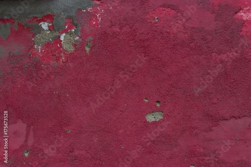 Plakat czerwony rozdrobnione farby na kamiennym murem