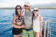Happy family on boat during tropical beach vacation