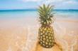 Fresh pineapple fruit on a tropical sandy beach