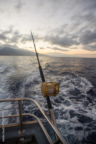 Printed kitchen splashbacks Fishing Deep Sea Fishing Reel on a boat during sunrise