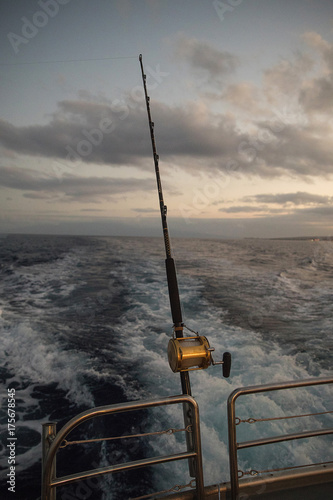 Poster Peche Deep Sea Fishing Reel on a boat during sunrise