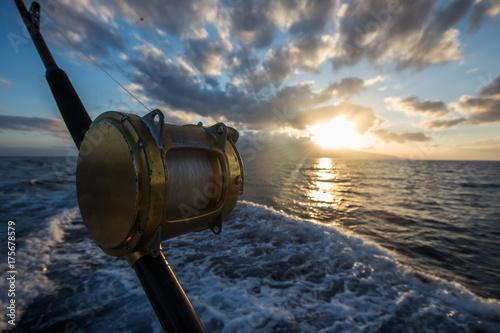 Fotografie, Obraz  Deep Sea Fishing Reel on a boat during sunrise