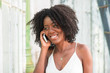 Smiling Attractive Black Woman Talking on Phone