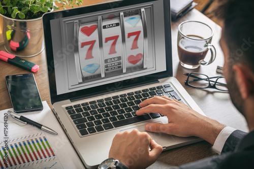 фотография  Slot machine on a laptop screen. 3d illustration