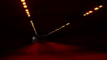 Smooth Cinematic Shot Of Driving Through A Highway Tunnel Near Golden Gate Bridge In San Francisco With Light Traffic On The Road