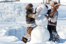 Children Shape The Snowman In ...