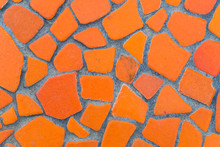 Texture Of Orange Tile Floor On Cement Walkway. The Front Walkway Is Built Of Inexpensive Cement In The Garden. Close Up Orange Rock Surface, Ideas For House And Garden Design. - Background Abstract.