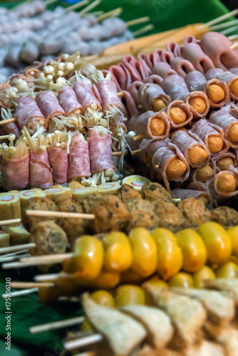 Hed Pun Ham Yang - Thai style barbeque street food on the night market in Chumph Poster
