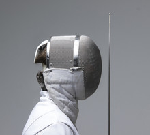 Profile Of A Fencer In Fencing...
