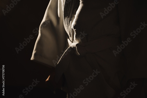 Young girl dressed in hakama practicing Aikido