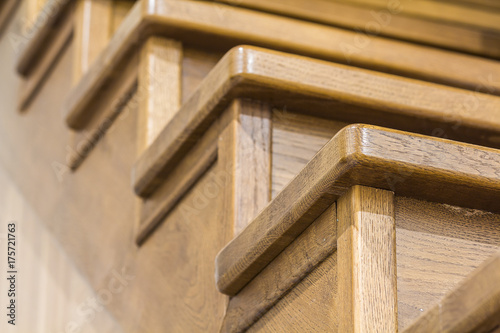 Foto op Canvas Trappen Detail close-up image of wooden oak stairs in house interior