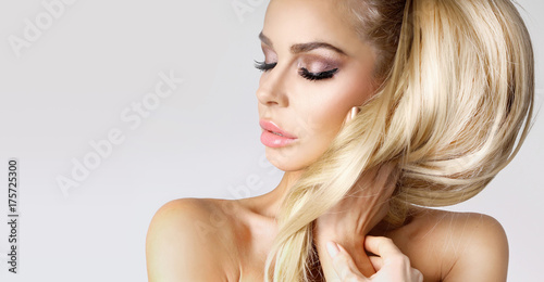 Fotografie, Obraz  Portrait beauty blonde female model with amazing long  hair and perfect face cle