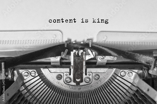 Foto op Plexiglas Retro content is king typed words on a vintage typewriter. Close-up.