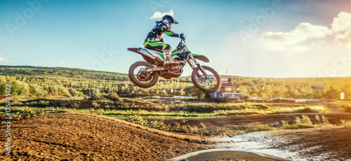 Foto op Plexiglas Motorsport Extreme Motocross MX Rider riding on dirt track