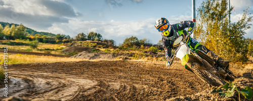 Fotobehang Motorsport Extreme Motocross MX Rider riding on dirt track