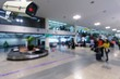 CCTV security indoor camera system operating with blurred image of passenger walking in airport terminal, people, transportation, surveillance security and safety technology concept