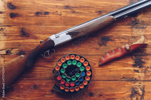 Foto op Canvas Jacht Hunting equipment. Shotgun, hunting cartridges and hunting knife on wooden table.