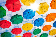 Many Colorful Umbrellas Hanging In The Sky