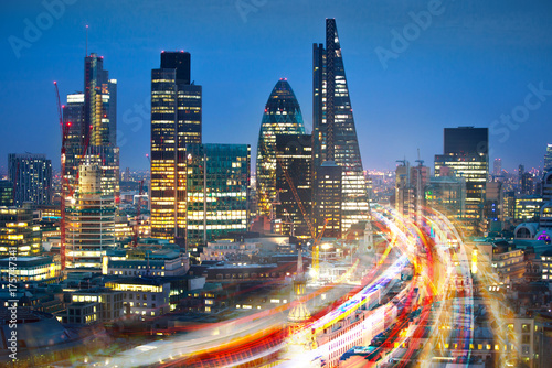 Poster London City of London at sunset and traffic blur lights on busy roads. Technology, transformation and innovation idea.