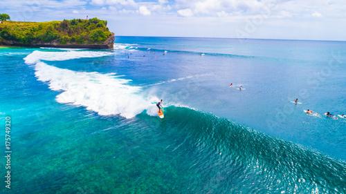 Surfers. Balangan beach. Bali, Indonesia. Wallpaper Mural