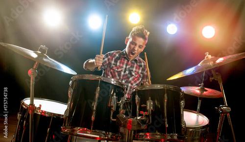 teenage boy behind drum kit