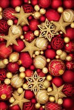 Christmas Gold And Red Bauble Decorations Forming An Abstract Background.