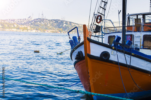 Keuken foto achterwand Schip old big ship in port of istanbul bosphorus river on sunset