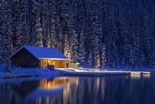 Night View Of Lake Louise Canoe Rental Log Cabin In Winter.  Banff National Park, Rocky Mountains Alberta Canada