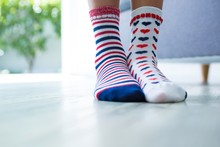 Low Section Of Girl Wearing Different Socks